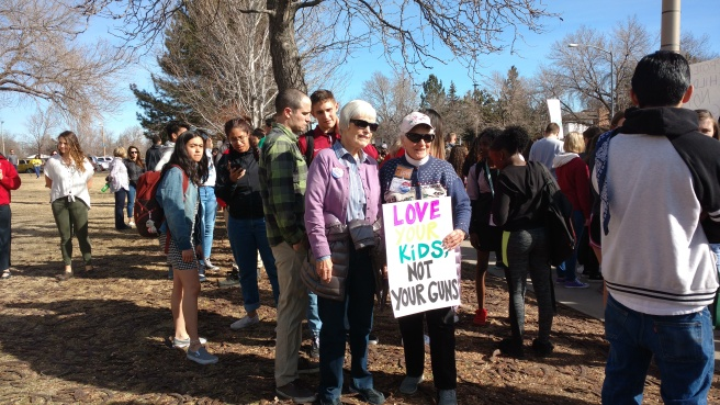 Grandmothers Priscilla Ledbury and Rhonda Whitney support students at the walk out on March 14.