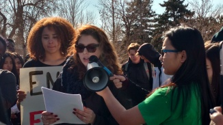 Senior Alyssa Schneider gives a speech at the walkout on March 14.